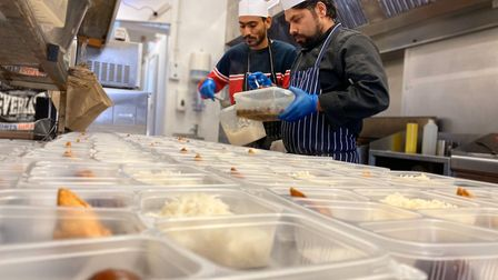 Chefs at Namaste Village Indian restaurant on Queens Road, Norwich, preparing meals for NHS frontlin