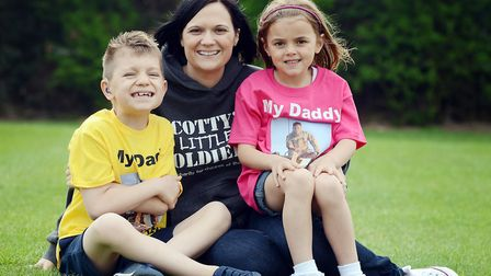 Nikki Scott of Scotty's Little Soldiers, with her children Kai and Brooke, who are running the fun r