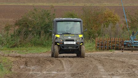 A officer uses a 4x4 truck to patrol remote farm tracks as part of Operation Galileo, a police crack