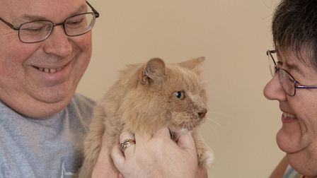 Keith, 53, and Su Bigland with his late mother's beloved pet cat, Biscuit, known as Bikkit, who has