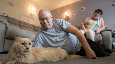 Keith, 53, and Su Bigland with his late mother's beloved pet cat, Biscuit, known as Bikkit. Photo cr