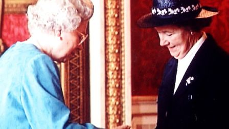 Yvonne Thirst collecting her late husband's MBE from the Queen