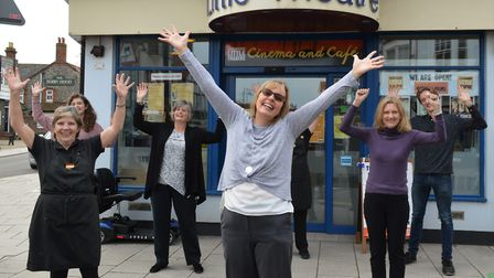 The team at Sheringham Little Theatre celebrating outside the theatre after receiving a lifeline £76