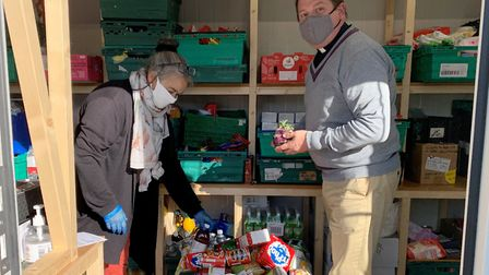 Reverend Matthew Price, vicar at St Mary Magdalene church in Gorleston, sorting food parcels during