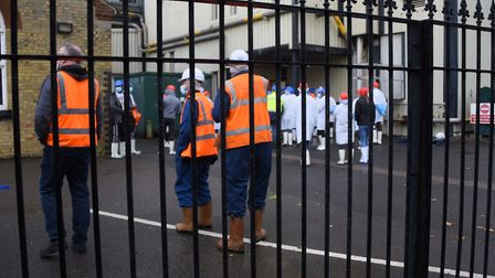 Staff make their way back into the building after the fire at Banham Poultry. Picture: DENISE BRADLE