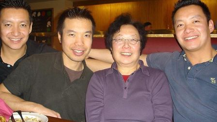 Sze-Ming Cheung (second from left) with his mother Wai-Hing (centre) and brothers Dick (far left) an