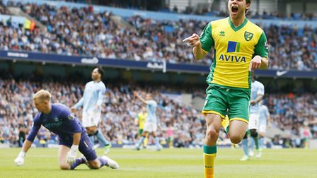 Jonny Howson celebrates scoring the third goal for Norwich City in their 3-2 win against Manchester
