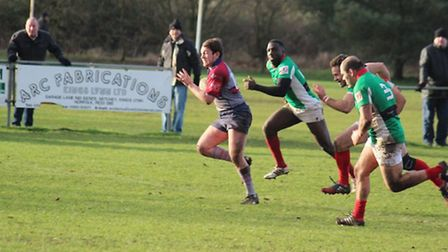 Action from West Norfolk, maroon and blue, against Battersea Ironsides on Saturday.