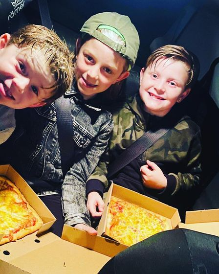 Max, George and Oliver taking part in the pizza roulette treasure hunt. Photo: Sam Alexander