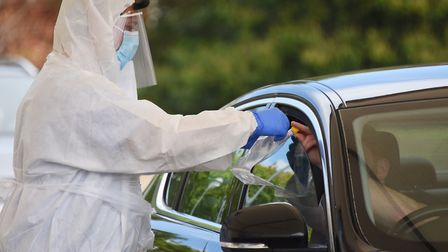 Nursing staff assist NHS staff and keyworkers to use the swabs at the drive through coronavirus test