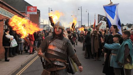 Flame torch-wielding warriors on the march at the 2020 Sheringham's Scira Viking Festival finale. P