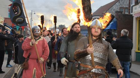 Flame torch-wielding warriors on the march at Sheringham's Scira Viking Festival finale. Photo: KAR