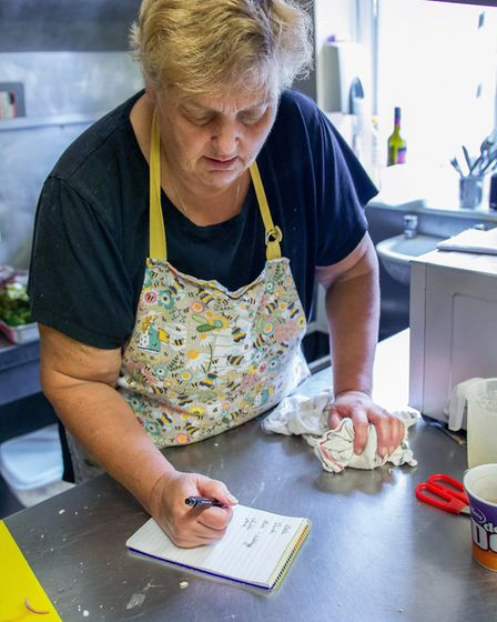 Julie Oatham, owner of The Butchers Arms in East Ruston, preparing meal orders ready for collection