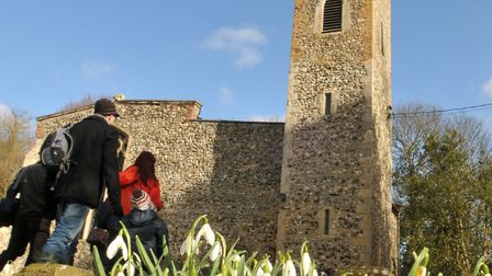 File picture of visitors enjoying a previous snowbell walk at St Peter's Church, Spixworth. Photo by