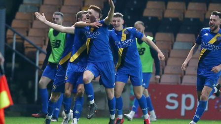 Sonny Carey is mobbed after his winner at Port Vale - Lynn will travel to Portsmouth in the second r