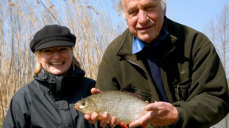 Geoffrey Palmer with his daughter, Harriett, and a fine roach Picture John Bailey