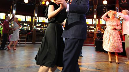 Champagne Charlie and Miss Anna lead the latin dancing during the Norfolk and Norwich Festival's tea