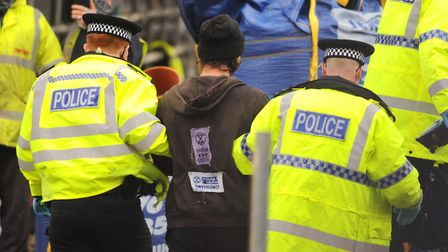 Police arrest and handcuff protester Alex Sidney as he comes down from the crane in Duke Street. Pic