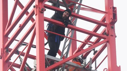 Alex Sidney ends his protest and comes down the crane in Duke Street, with fire search and rescue cr