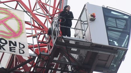 Protester Alex Sidney as he ends his vigil up the crane in Duke Street. Picture: DENISE BRADLEY
