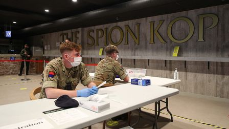 Members of the military use Anfield stadium as part of the mass testing taking place in the city of