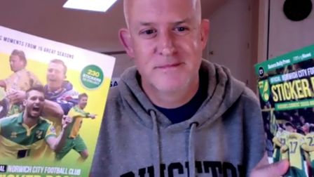 Princeton University professor Andy Reynolds with his two Norwich City sticker albums. Picture: Andy