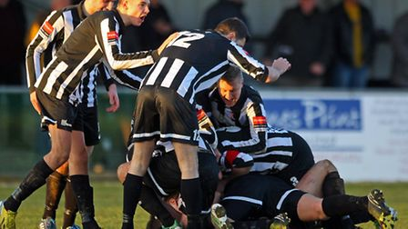 Dereham Town celebrate Adam Smith's winner on Saturday. (Photo by Paul Chesterton/phcimages.com)