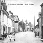 Children playing in the High Street, Cley. Picture: courtesy of the Mike Adcock Collection