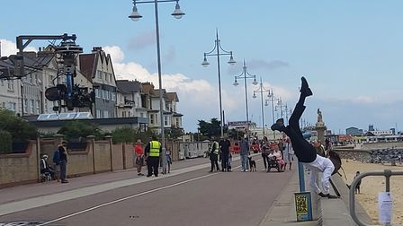One of the four dancers on the promenade at Lowestoft seafront filming the closing scenes for the ne