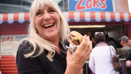 Sue Allen, who started working with Zaks in 1978, with one of their burgers at the replica Zaks burg