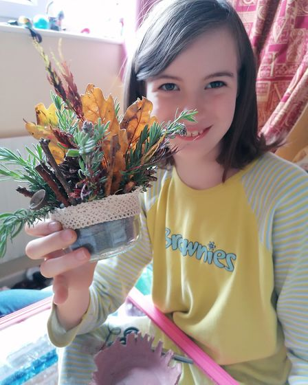 Imogen James (9), was among the 1st Toftwood Brownies who took part in autumn-themed activities duri