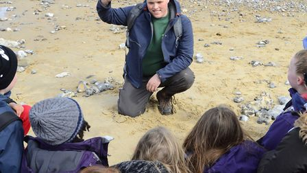 Children learn about a mammoth tooth found on West Runton Beach during their stay at Aylmerton Outdo