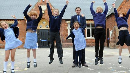 Blofield Primary School head, Oliver Burwood, with some of the children celebrating their outstandin