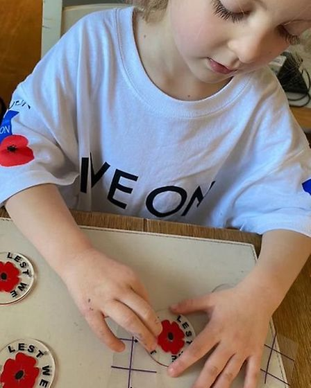 Felicity Bell creating the keyrings she used to raise money for the British Legion. Picture: Joe Bel