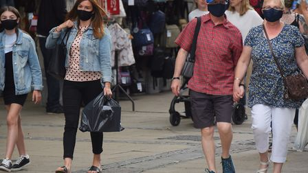 Shoppers in facemasks in Norwich. Picture: DENISE BRADLEY