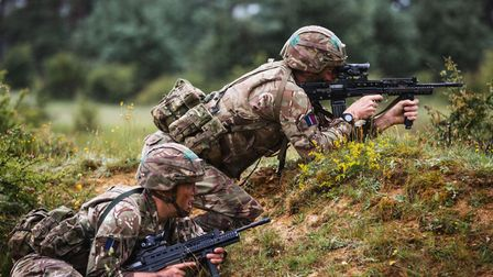 Trainee RAF Regiment gunners from Mekitila Flight take part in section attack drills on the 8th July