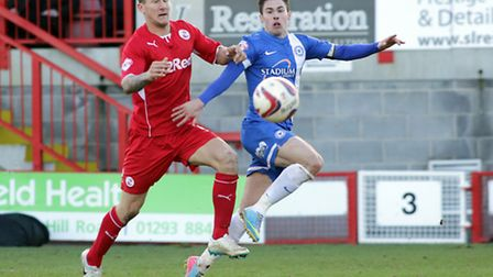 Peterborough United's Tommy Rowe in action with Crawley Town's Kyle McFadzean - Photo mandatory by-l