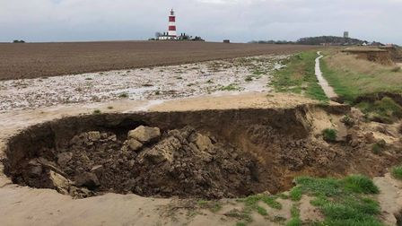 The remaining debris after two separate cliff falls happened along Happisburgh Beach Picture: NEIL
