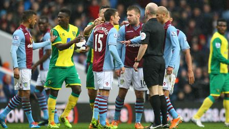 The players confront referee Anthony Taylor after a bad tackle by Alex Tettey on Villa's Nathan Bake