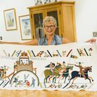 Volunteer Vivienne Tuddenham, from Acle, with her finished panel for the Norwich Friends Tapestry,