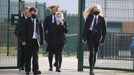 Pupils wearing face coverings as they arrive at school. Picture: PA Images