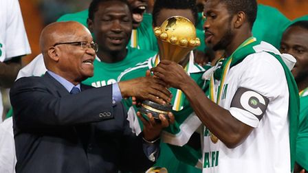 South Africa's President Jacob Zuma, left, hands the African Cup of Nations trophy to Nigeria's team