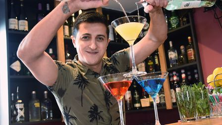 Flair bartender Cem Peksen creating cocktails in his cocktail and wine house, Bar 14, above his café