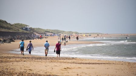 Holidaymakers enjoy the warm weather at Sea Palling beach Picture : ANTONY KELLY