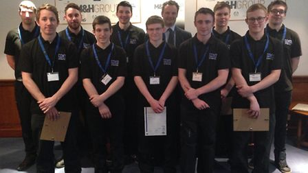 Apprentices at M&H Plastics in Beccles with Waveney MP Peter Aldous