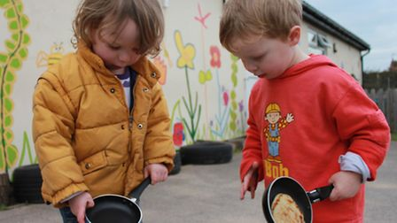 Three-year-olds VincentTyler and Danny Dawson have a go at flipping pancakes. Photo: Karen Bethell