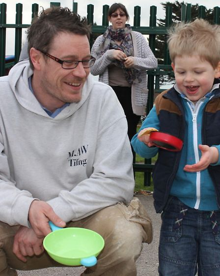 Three-year-old Ross Birley and dad Michael try their hands at pancake flipping. Photo: Karen Bethell
