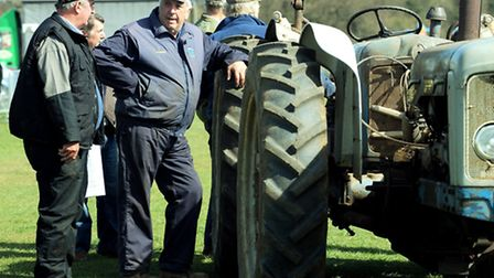 Farmers show what tractors are really for - somewhere to lean while having a good mardle at the vint
