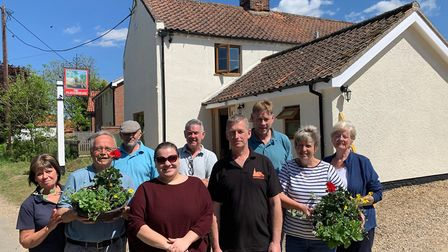 Some of the team who helped to Beeston Ploughshare pub. Pictured front and centre are the new pub ma