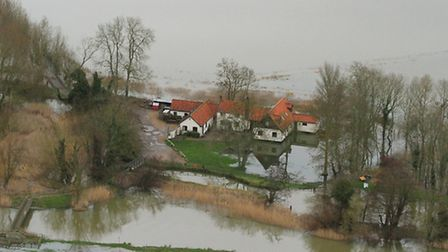 The dramatic picture, which shows how the pub is standing proud surrounded by water on all sides, wa